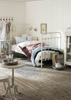 Darling bedroom, that iron bed is amazing.