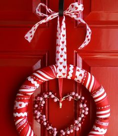 I don't normally decorate for V-Day, but after I made those ribbon wreaths for Halloween  & Christmas , I knew that I'd be ma...