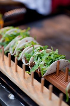 mini tacos with fresh greenery are ideal for serving at the wedding, for appetizers and for late-night snacks Mini Tacos, Taco Holders, Taco Stand, Wedding Appetizers, Wedding Snacks, Wedding Appetizer Table, Taco Bar Wedding, Wedding Canapes, Party Canapes