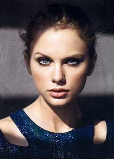 Taylor Swift in a sparkly blue double strap dress in Marie Claire