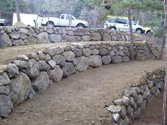boulder retaining wall design like the use of large and smaller boulders