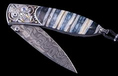 """William Henry's Monarch """"Sparkie"""" features a hand-engraved frame with 24K gold and copper inlays by Aleksey Saburov, inlaid with fossil Woolly Mammoth tooth. The blade is stainless Hornets Nest damascus by Mike Norris, and the button lock and thumb stud are set with sapphires."""