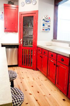 corner pantry · Country Pantry door · Custom Pantry Door · Distressed Cabinets · Pantry Door · Pine Flooring · Red Cabinets · Screen Door Pantry · Shaker Style Doors · Stainless Appliances · Subway Tile