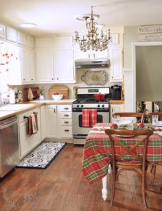 White eat in kitchen decorated with plaid. Basically my dream kitchen.