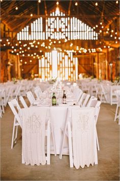 mr and mrs chair banners in barn style wedding reception #barnwedding #weddingseating #weddingchicks http://www.weddingchicks.com/2014/03/17/central-coast-summer-wedding/