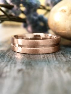 Ooh, this rose gold wedding band from Etsy seller stonesandgold... we are FEELING YOU.