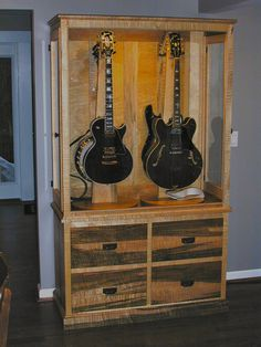 One of my latest custom builds a lighted guitar display case.  Built in figured curly maple with a natural finish.  Holds four insturments with side door access and four large storage drawers in base.  Enjoy...