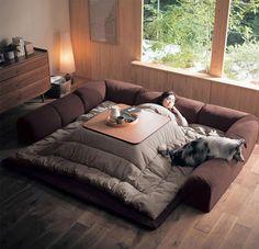 Котацу — традиционный японский предмет мебели, низкий деревянный каркас стола, накрытый японским матрацем футоном или тяжелым одеялом, на который сверху положена столешница. Под одеялом располагается источник тепла, часто встроенный в стол.