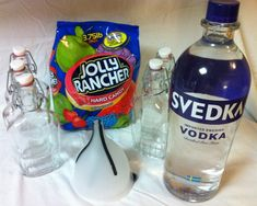 Jolly Rancher Vodka...YUM!!!  * A liter of vodka  * 12 Jolly ranchers in each flavor you want to infuse  * Five flasks to pour it in  * Funnel  Step 1: Sort the Jolly Ranchers  Step 2: Put Jolly Ranchers in flasks  Step 3: Pour the vodka  Step 4: Chill!  Mix any of the flavors with some mineral/soda water or 7-up or Sprite. Or get creative and make up your own signature cocktails!