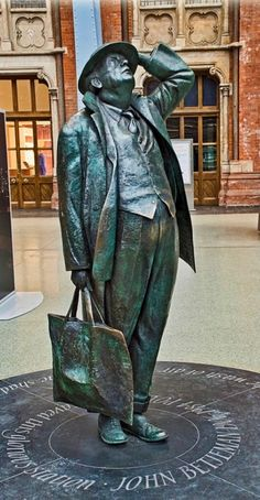 "Sir John Betjeman was British Poet Laureate from 1972 to 1984. A lover of Victorian architecture he campaigned vigorously in the 1960s against the proposed demolition of St. Pancras station. Beneath him reads ""John Betjeman 1906-1984, poet, who saved this glorious station"" :D http://en.wikipedia.org/wiki/John_Betjeman"