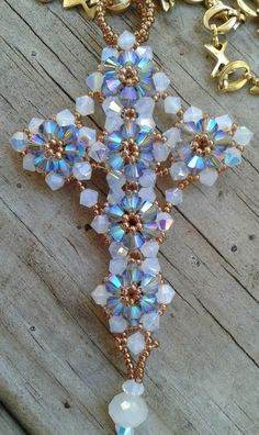 As you can see I have been busy working on Christmas already. It is just around the corner! I have 12 Ornaments to start and finish . Beaded Jewelry Patterns, Beading Patterns, Beaded Ornament Covers, Beadwork Designs, Beaded Christmas Ornaments, Bead Loom Bracelets, Beaded Cross, Cross Jewelry, Bead Jewellery