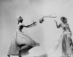 The joyful tradition of tossing the bouquet as captured in 1945. #vintage #wedding #1940s #bride #bouquet