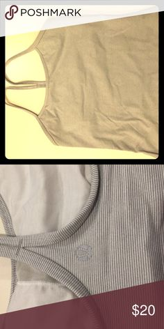 Lululemon striped Power Y tank size 6 White and light grey fine striped size 6 lulu power Y tank. Built in bra makes this too easy to wear with no sports bra. Looks light grey from far away. Stripes are very skinny. lululemon athletica Other
