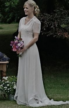 1940s wedding dress..something about this and the simpleness makes me feel warm and fuzzy.