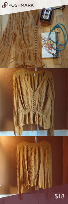 Free People Button Up Blouse Burnt Orange Size Medium100% Polyester. Flowy button up long sleeve top with tied back, bronzed embroidery throughout and single button closures at each wrist. Fraying on detail towards the bottom of front is photographed. Free People Tops Blouses