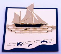 Greeting card pop-up art of sailboat.  It is a combination of folding art (origami) and the art of cutting (kirigami).  - The card comes with a white