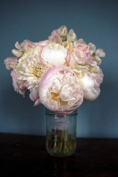 peach wedding flowers bridal bouquet - love how the pink fades into the petals. #weddings