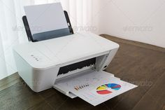 Buy Printer with financial documents on a wood table by on PhotoDune. Printer with financial documents on a wood table Best Printers, Home Printers, Wireless Printer, Brother Printers, Laser Printer, Wood Table, Printing Services, Home Goods, Storage