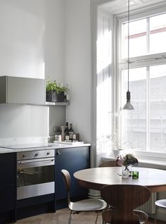 "This is my future kitchen! Dark blue cabinets with leather handles paired with Arne Jacobsen ""Myren"" in dark wood. Love at first sight!"