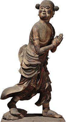 「善財童子立像ぜんざいどうじりゅうぞう」(文殊菩薩および侍者のうち) 鎌倉時代・建仁3年(1203)~承久2年(1220)/奈良・安倍文殊院あべもんじゅいん蔵 4人の侍者とともに海を渡って我々のところに来ようとする文殊五尊像のうちの1体です。文殊菩薩の像内に建仁3年(1203)、運慶と並び称される仏師・快慶がつくったことを記す銘文があります。一具の仏陀波利三蔵像ぶっだはりさんぞうも出品されます。2013年(平成25年)に指定された最も新しい国宝の彫刻です。