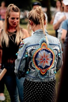 Fall festivals on the books? Here's your go-to outfit - pair your customized Levi's denim jacket with a pair of graphic pants and an easy fishtail braid.   Photo: Sebastian Berthold