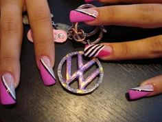 Pink Nails With White And Black Decorations