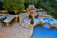 Mediterranean Patio with Fence, Outdoor stone fireplace, Exterior accent lighting, Covington Cushioned Swivel Chair, Pathway