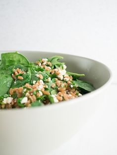 Herb and Spinach Farro Salad   An easy, fresh, spring spinach farro salad full of herbs and tart feta cheese. Perfect for a light picnic lunch or dinner.   SeasonedVegetable.com