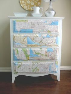 Maps on dressers...  NEED to do this for my boyfriend!!  He is a Geography major and is obsessed with MAPS!!  Only it would be better with the old world maps.