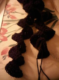 Would be an easy crochet project--and fast.  Curly scarf.