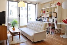 This vintage white sofa bed only cost them less than $100 off eBay!