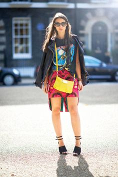 Shop this look on Lookastic:  http://lookastic.com/women/looks/crossbody-bag-sunglasses-crew-neck-t-shirt-biker-jacket-mini-skirt-heeled-sandals/2275  — Yellow Leather Crossbody Bag  — Black Sunglasses  — Black Print Crew-neck T-shirt  — Black Leather Biker Jacket  — Hot Pink Print Mini Skirt  — Black Suede Heeled Sandals