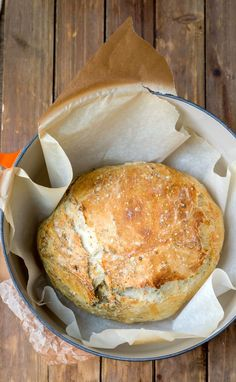 Garlic Herb No Knead Bread is an easy recipe that makes a delicious, flavorful, artisan loaf of bread in the Dutch oven with little hands-on work! Great no knead bread variation!