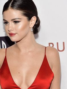 Selena Gomez looks amazing. Check out makeup trends and new techniques to look glam like Selena at https://youtube.com/pagekarlabeauty