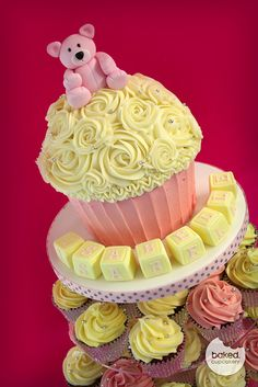 large cupcake tower - think I could use Pampered Chef Batter bowl for form -- just cut off bottom to make it flatter - then go to town with icing or whipped cream!