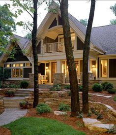 Covered upstairs porch, columns.  What a charming home! #craftsmanstyle