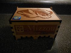 Cherry Box emblazoned with the official Missouri Tiger, and Mizzou signature.  Size is 6-3/4 long by 4-3/4 Wide X 3 Deep