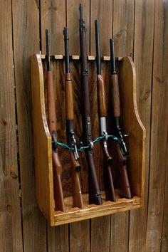 Our 5 gun rifle rack is built to last with durable, solid pine wood. Will fit 5 . Wooden Pallet Projects, Wooden Pallets, Wooden Diy, Nerf Gun Storage, Weapon Storage, Rifle Stand, Gun Cabinet Plans, Hidden Gun Cabinets, Gun Closet