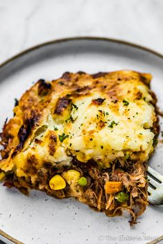 Pulled pork shepherd's pie is a delicious twist on a classic recipe. It's made with tender pulled pork, tasty sauteed veggies, and creamy mashed potatoes baked together in a casserole dish. #theendlessmeal #pulledpork #pulledporkshepherdspie #shepherdspie #cottagepie #italianshepherdspie #pork #casserole #cozy Pork Casserole, Casserole Dishes, Cottage Pie, Creamy Mashed Potatoes, Pulled Pork, Classic Recipe, Veggies, Lasagna, Tasty
