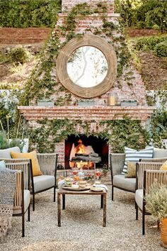 And speaking of obsessed, oh my! This outdoor space is so fabulous! That mirror is the perfect complement to the rustic brick fireplace. And there is something so soothing about the sound of gravel. Such a gorgeous outdoor room!