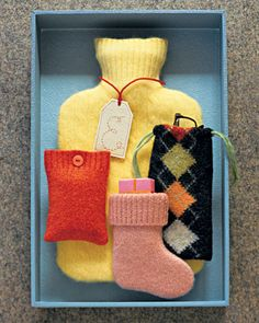 Pieces of sweaters can make a variety of pouches.  Hot Water-bottle cover, eyeglass case, stocking MP3 player cover.  Cute idea Martha!