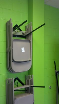 """Folding Chair Rack by aka Larry -- Homemade folding chair rack fabricated from 1/8"""" X 1.5"""" flat bar stock and 3/4"""" square tubing. http://www.homemadetools.net/homemade-folding-chair-rack"""