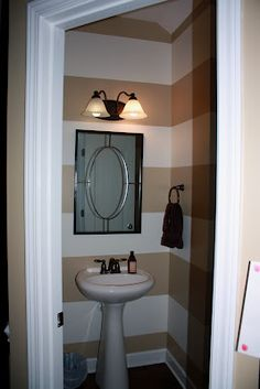 LOVE the stripes in this bathroom!
