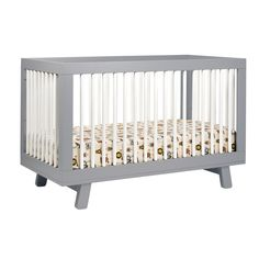 Decorate your baby's bedroom in a midcentury-modern design with this adorable convertible crib.