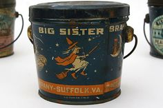 Big Sister Brand Peanut Butter Halloween Pail - 1 LB peanut butter pail, marked Suffolk, Virginia, U.S. Can C.O., Cin. O, . Fully printed all around with double witches riding a broom, owl on the moon, with stars on blue ground, two children riding a peanut through the night sky, orange band.