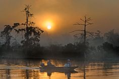 Sun shrouded in early morning fog just after sunrise today — at Bayou Castine-- Mandeville, LA. By John Snell