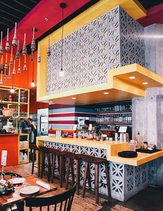 HGTV loves this Mexican taqueria restaurant with pink, red and yellow paint; yellow bar and rustic wood bar stools. Pink Restaurant, Mexican Restaurant Design, Mexican Interior Design, Mexican Bar, Modern Restaurant, Restaurant Interior Design, Mexican Style, Colorful Restaurant, Coffee Shop Design