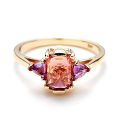 (Pink Tourmaline/ Ruby/ Gold ring) Ring Yellow Gold with aPink Tourmaline center flanked byRuby Trillions.