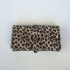 Leopard Print travel jewelry organizer Leopard Print travel jewelry case. Perfect for your summer vacation. Lots of little compartments for you can stay organized! When closed 7 3/4 inches wide, 4 1/4 inches tall, 1 1/2 inches wide. All measurements are approximate. Bags Travel Bags