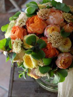 Fleurs Trémolo  soft yellows, apricot and cream colors in lovely floral arrangement